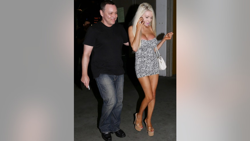 Courtney Stodden and Doug Hutchison leaving Arclight after a movie and she's wearing her typical uniform of a tiny dress and stiletto heels.