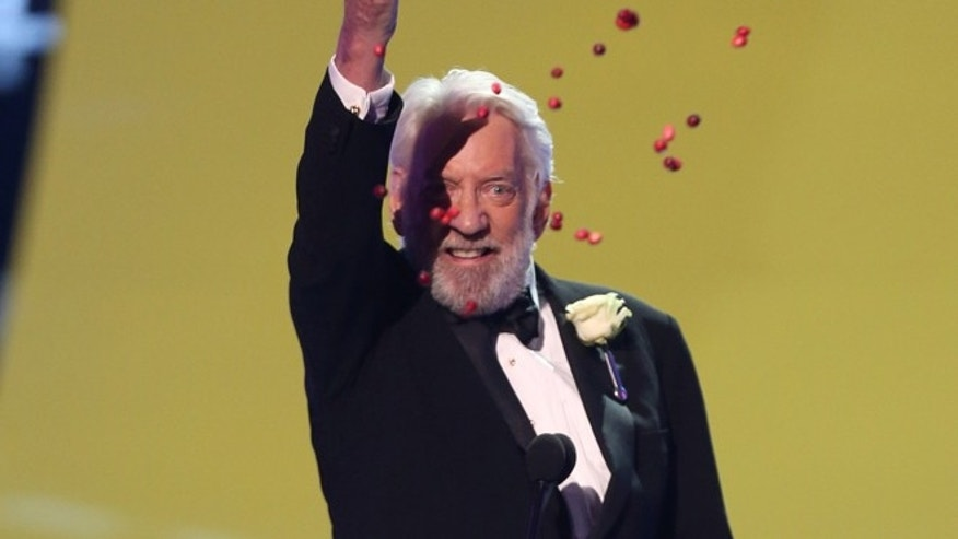 "Donald Sutherland accepts the award for choice movie villain for The Hunger Games: Catching Fire"" at the Teen Choice Awards at the Shrine Auditorium on Sunday, Aug. 10, 2014, in Los Angeles. (Photo by Matt Sayles/Invision/AP)"