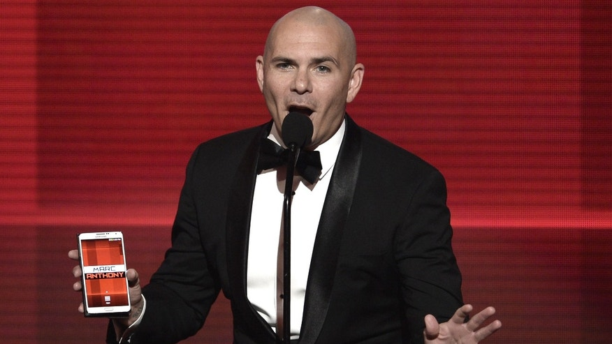 Pitbull during the 2013 American Music Awards at Nokia Theatre L.A. Live on November 24, 2013 in Los Angeles, California.