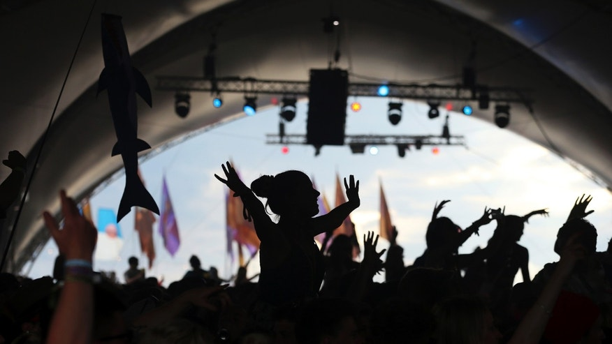 Festival goers dance during the Glastonbury Festival June 28, 2014.