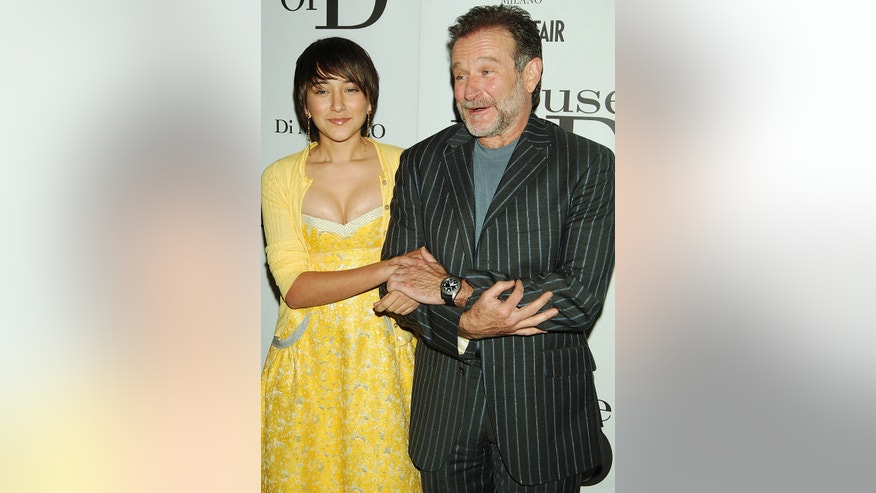 "Williams posed with his daughter Zelda Williams during the premiere of their film ""House of D"" in 2005."