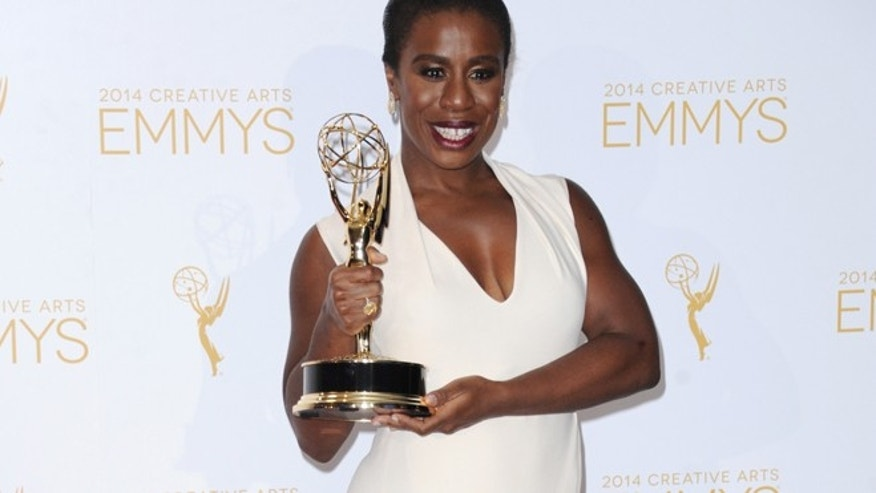 Aug. 16, 2014: Uzo Aduba poses in the press room with the award for outstanding guest actress in a comedy series for Orange Is the New Black at the 2014 Creative Arts Emmys at Nokia Theatre L.A. LIVE in Los Angeles. (AP)