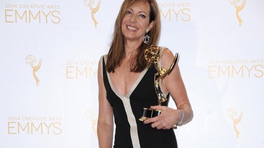 Aug. 16, 2014: Allison Janney poses in the press room with the award for outstanding guest actress in a drama series for her work on Masters of Sex at the 2014 Creative Arts Emmys at Nokia Theatre L.A. LIVE in Los Angeles. (AP)