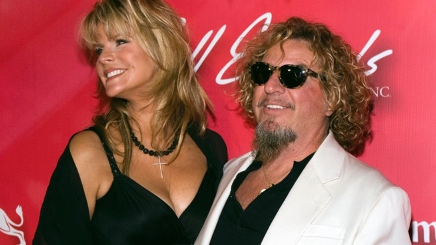 "Rocker Sammy Hagar and wife Kari arrive for the 16th annual Keep Memory Alive ""Power of Love Gala"" and 70th birthday celebration for Muhammad Ali at the MGM Grand Garden Arena in Las Vegas, Nevada February 18, 2012. Proceeds from the event benefit the Cleveland Clinic Lou Ruvo Center for Brain Health in Las Vegas and the Muhammad Ali Center in Louisville, Kentucky. REUTERS/Steve Marcus (UNITED STATES - Tags: ENTERTAINMENT SPORT BOXING) - RTR2Y33O"