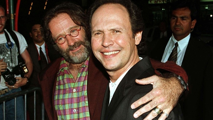 "Actor Robin Williams put his arm around co-star Billy Crystal when they arrived for the premiere of their film ""Father's Day"" May 6, 1997 at Mann's Chinese Theatre."