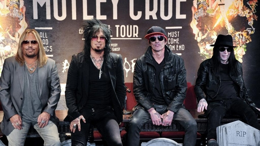 "FILE - This Jan. 28, 2014 file photo shows, from left, Vince Neil, Nikki Sixx, Tommy Lee, and Mick Mars of Motley Crue at a press conference in Los Angeles. Country artists including Rascal Flatts, Florida Georgia Line and Brantley Gilbert perform on the 15-song album ""Nashville Outlaws: A Tribute to Motley Crue,"" released Tuesday, Aug. 19. (Photo by Richard Shotwell/Invision/AP, File)"
