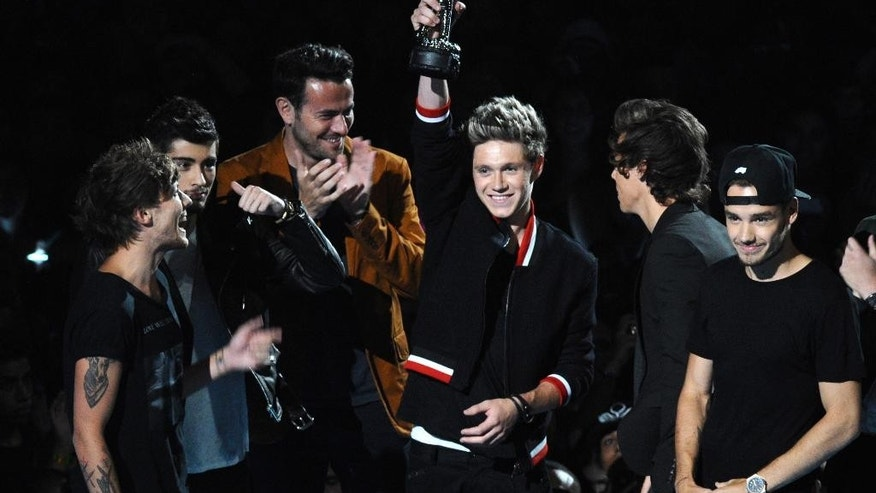 FILE - This Aug. 25, 2013 file photo shows the British group One Direction accepting the award for song of the summer at the MTV Video Music Awards at the Barclays Center in the Brooklyn borough of New York. (Photo by Charles Sykes/Invision/AP, File)