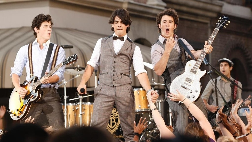 FILE - This Sept. 7, 2008 file photo shows The Jonas Brothers, from left, Nick Jonas, Joe Jonas and Kevin Jonas performing at the 2008 MTV Video Music Awards in Los Angeles. (AP Photo/Matt Sayles, File)