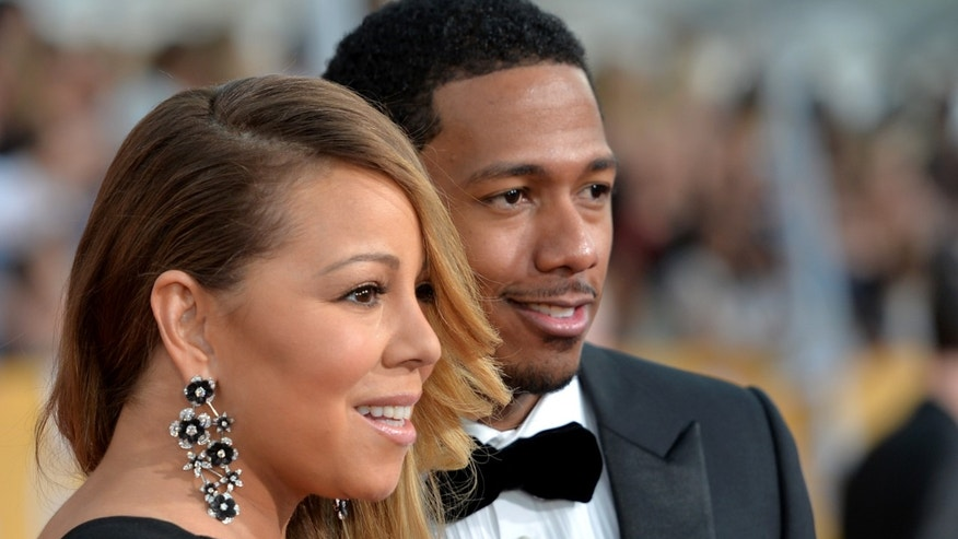 LOS ANGELES, CA - JANUARY 18:  Singer Mariah Carey (L) and TV personality Nick Cannon attend the 20th Annual Screen Actors Guild Awards at The Shrine Auditorium on January 18, 2014 in Los Angeles, California.  (Photo by Alberto E. Rodriguez/Getty Images)