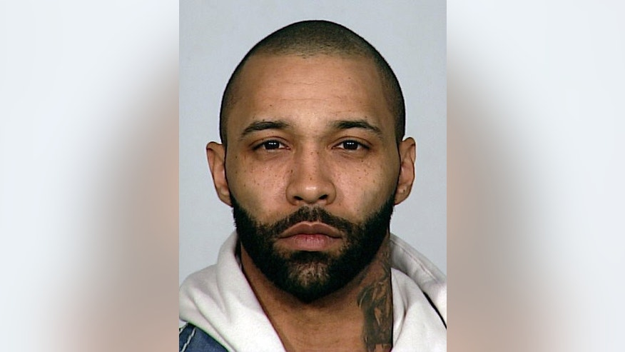 In this undated photo provided by the New York City Police Department, rapper and reality show star Joe Budden is shown.
