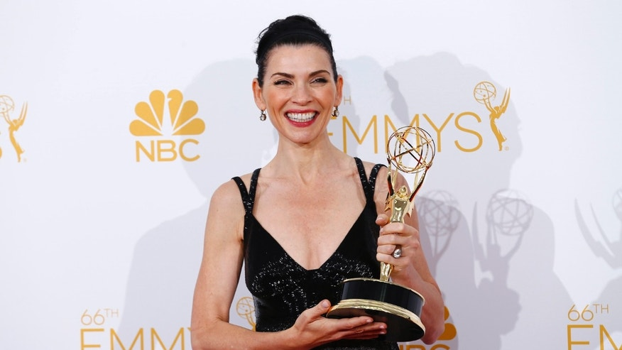 "Julianna Margulies poses backstage with her award for Outstanding Lead Actress in a Drama Series for the CBS series ""The Good Wife"" at the 66th Primetime Emmy Awards in Los Angeles, California August 25, 2014.  REUTERS/Mike Blake (UNITED STATES -Tags: ENTERTAINMENT)(EMMYS-BACKSTAGE) - RTR43QQV"