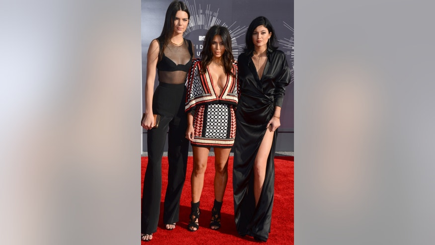 Between Kendall's (L) mom pants, Kim's (C) low cut poncho dress and Kylie's (R) way-too-big silk robe-like dress, these sisters need a new stylist pronto!