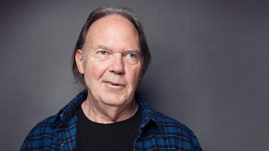 FILE - This Sept. 27, 2012 file photo shows singer-songwriter Neil Young posing for a portrait at The Carlyle hotel in New York. Young has raised more than $6 million through a Kickstarter campaign to fund his digital music project PonoMusic. Kickstarter closed the campaign Tuesday after raising 6.2 million through 18,000 supporters. The campaign is the third most funded project for Kickstarter. (Photo by Victoria Will/Invision/AP, file)