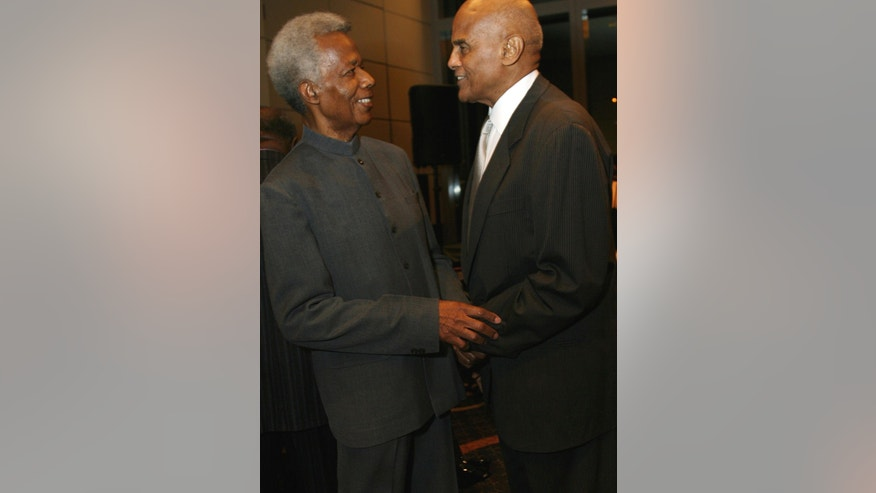 "FILE - In this Oct. 6, 2006, file photo, filmmaker William Greaves, left, and talks with actor Harry Belafonte at the 80th anniversary celebration of Harlem's Schomburg Center at Jazz at Lincoln Center in New York. Greaves, the Emmy-award winning producer and co-host of the groundbreaking television show ""Black Journal"" and a prolific filmmaker whose subjects ranged from Muhammad Ali to the Harlem Renaissance to the black middle class, has died. He was 87."