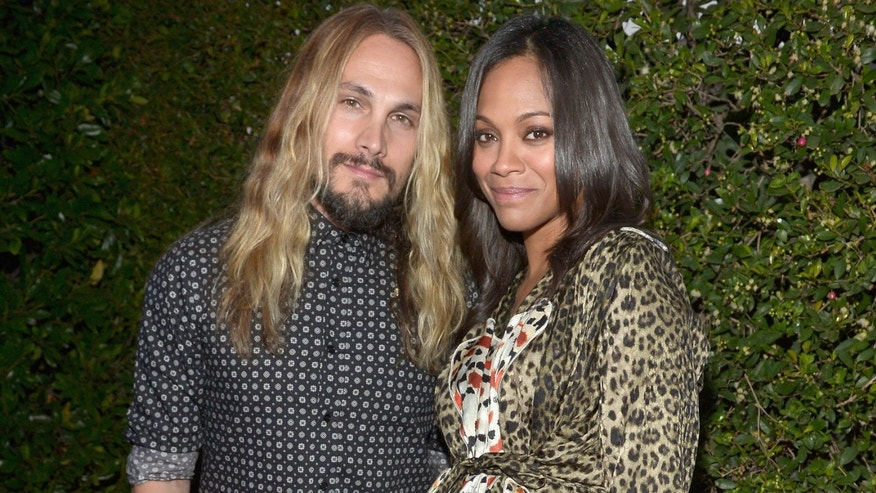 LOS ANGELES, CA - AUGUST 21:  Actress Zoe Saldana (L) and Marco Perego attend Audi's Celebration of Emmys Week 2014 at Cecconi's Restaurant on August 21, 2014 in Los Angeles, California.  (Photo by Charley Gallay/Getty Images for Audi)