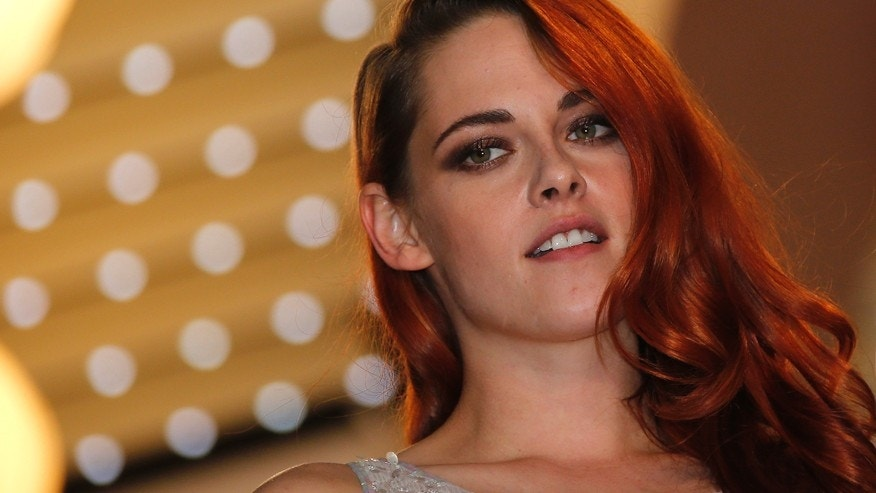 "Cast member Kristen Stewart poses on the red carpet as she leaves after the screening of the film ""Sils Maria"" (Clouds of Sils Maria) in competition at the 67th Cannes Film Festival in Cannes May 23, 2014."