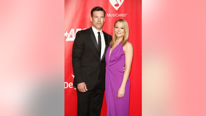 January 24, 2014. Actor Eddie Cibrian (L) and singer LeAnn Rimes (R) pose at the 2014 MusiCares Person of the Year gala honoring Carole King in Los Angeles.