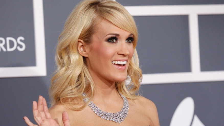 Singer Carrie Underwood arrives at the 55th annual Grammy Awards.