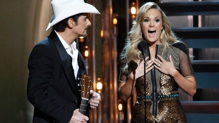 Nov. 6, 2013: Co-hosts Brad Paisley, left, and Carrie Underwood perform at the 47th annual CMA Awards at Bridgestone Arena, in Nashville, Tenn.