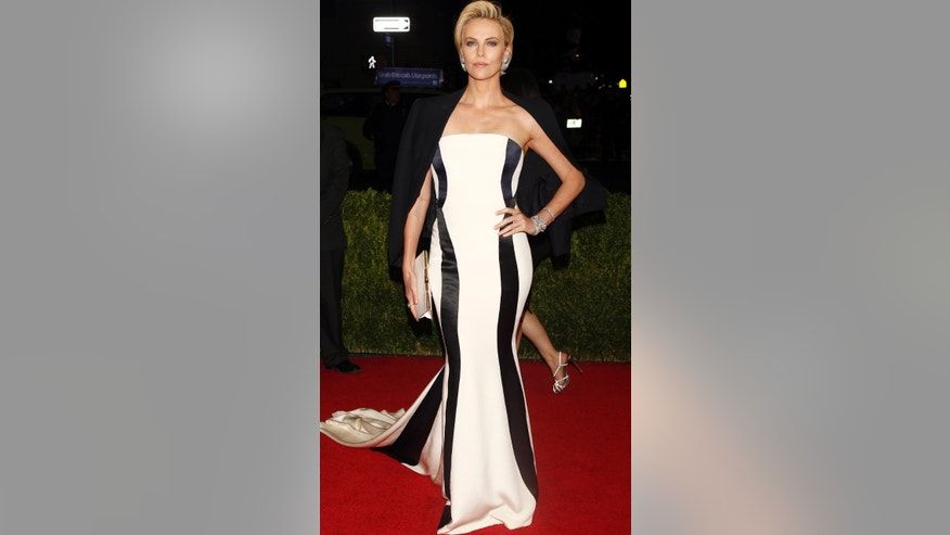 "Actress Charlize Theron arrives at the Metropolitan Museum of Art Costume Institute Gala Benefit celebrating the opening of ""Charles James: Beyond Fashion"" in Upper Manhattan, New York May 5, 2014."