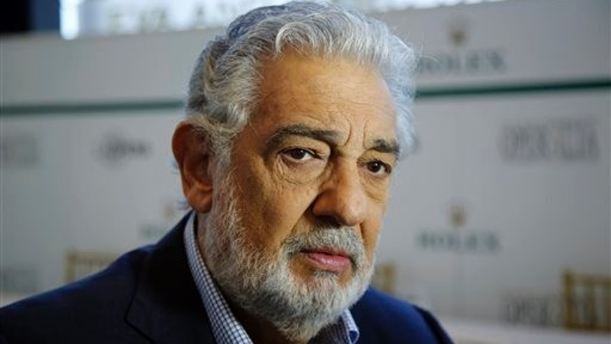 Spanish tenor Placido Domingo gives details about the opera competition Operalia at the Dorothy Chandler Pavilion in Los Angeles, Tuesday, Aug. 26, 2014. Domingos Operalia, the World Opera Competition, returns to Los Angeles and will be held from Aug. 25 through Aug. 30. (AP Photo/Damian Dovarganes)