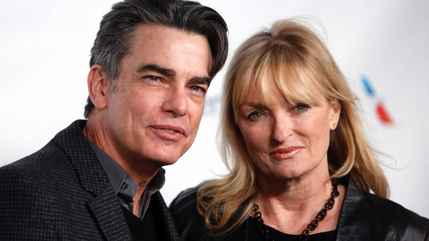 Actor Peter Gallagher and wife Paula Harwood.