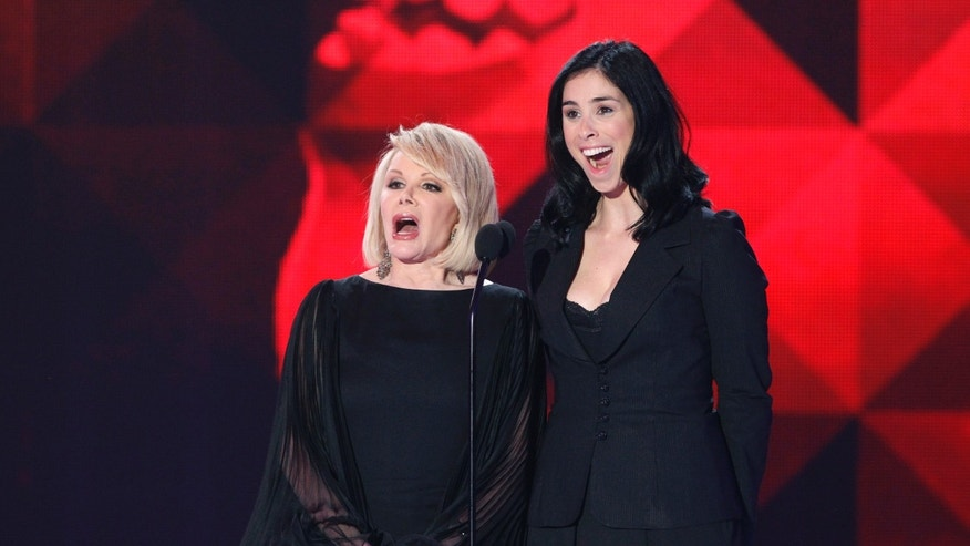 Joan Rivers (L) and Sarah Silverman speak on stage at the 16th Annual Critics' Choice Movie Awards in Hollywood, California January 14, 2011.  REUTERS/Mario Anzuoni  (UNITED STATES - Tags: ENTERTAINMENT) - RTXWL0Q
