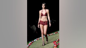 FILE - In this Sept. 8, 2014 file photo provided by Starpix, Kendall Jenner models fashion from the Tommy Hilfiger Spring 2015 collection during Fashion Week in New York. No Fashion Week is complete without some sort of Kardashian. There was no Kim or Kanye in sight this time, but Jenner, Kim's half-sister, continued her ascent in the business, appearing on high-profile runways including that of Diane von Furstenberg, Marc Jacobs, and Donna Karan. (AP Photo/Starpix, Aurora Rose, File)
