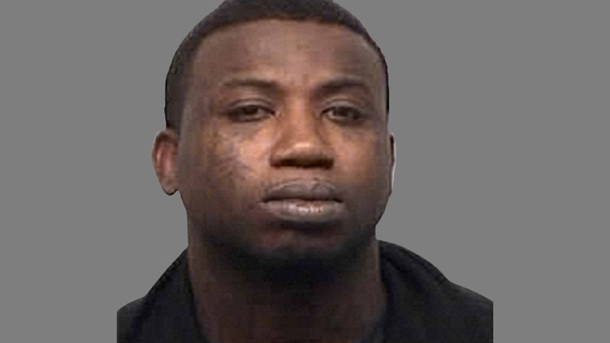 Rapper Gucci Mane after his arrest on aggravated assault charges for allegedly hitting a fan on the head with a champagne bottle.
