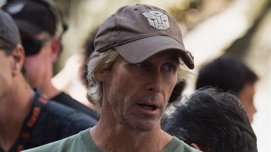 "Oct. 18, 2013: U.S director and producer Michael Bay speaks during the filming of a scene for the movie ""Transformers: Age of Extinction"" in Hong Kong."