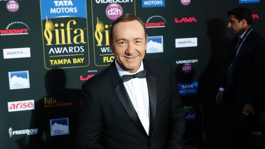 """FILE - In a April 26, 2014 file photo, actor Kevin Spacey walks the green carpet as he arrives for the 15th annual International Indian Film Awards, in Tampa, Fla. A Massachusetts woman, Linda Louise Culkin of Quincy, Mass., who threatened to blow up, torture and castrate Spacey in what prosecutors called a """"persistent and malevolent"""" cyberstalking campaign, was sentenced Wednesday, Sept. 17, 2014, to more than four years in prison. A federal judge in Boston also ordered Culkin to pay Spacey $124,000 in restitution for bodyguards.The 55-year-old Culkin has been jailed since January 2012, meaning she has about 18 months left to serve. She pleaded guilty in November to charges including mailing threatening communications, and sending false information regarding explosives.(AP Photo/Brian Blanco, File)"""