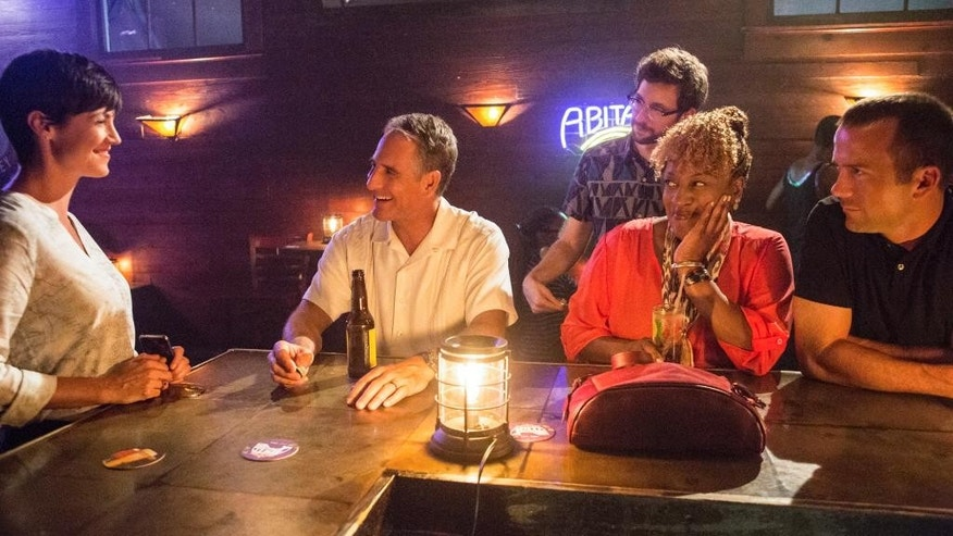 "In this photo released by CBS, from left, Zoe McLellan as Special Agent Meredith ""Merri"" Brody, Scott Bakula as Special Agent Dwayne Pride, Rob Kerkovich as Sebastian Lund, CCH Pounder as Dr. Loretta Wade, and Lucas Black as Special Agent Christopher LaSalle, in a scene from ""NCIS: New Orleans,"" Sept. 23, 2014 (9:00-10:00, ET/PT), on the CBS Television Network. The ""NCIS"" franchise will expand with the series set in New Orleans that debuts Tuesday, Sept. 23, on CBS. (AP Photo/CBS, Skip Bolen)"