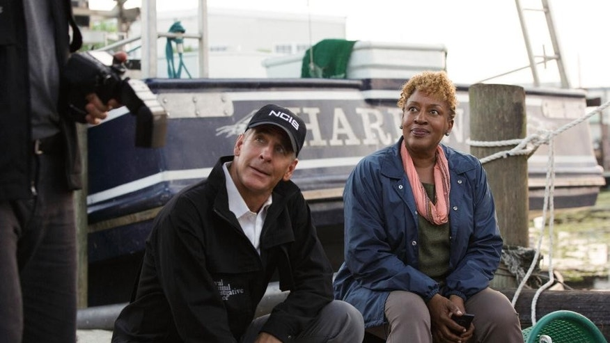 "In this photo released by CBS, Scott Bakula, left, as Special Agent Dwayne Pride and CCH Pounder as Dr. Loretta Wade, in a scene from season 1, ""NCIS: New Orleans,"" Sept. 23, 2014 (9:00-10:00, ET/PT), on the CBS Television Network. The ""NCIS"" franchise will expand with the series set in New Orleans that debuts Tuesday, Sept. 23, on CBS. (AP Photo/CBS, Michele K. Short) **MANDATORY CREDIT**"