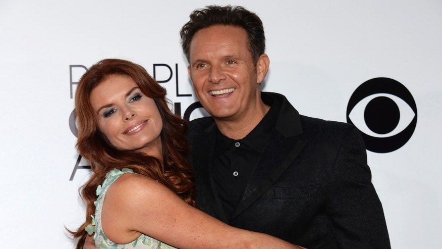 January 8, 2014: Television producer Mark Burnett and his wife Roma Downey arrive at the 2014 People's Choice Awards in Los Angeles, California .