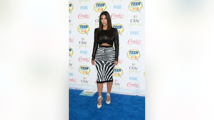August 10, 2014. Kim Kardashian arrives at the Teen Choice Awards 2014 in Los Angeles, California.
