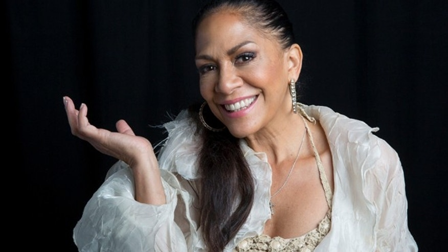 "FILE - In this Sept. 2, 2014 file photo, Grammy-nominated singer, Sheila E poses for a portrait in support of her new album ""The Beat of My Own Drum"" released, Tues., Sept. 2, 2014 in New York. The musicianâs memoir released through Simon & Schusterâs Atria Books, features stories about working with Marvin Gaye, Ringo Starr and Lionel Richie to being raped at age five. Sheila E. said dating Prince and Santana made her realize she had a thing for guys with guitars. (Photo by Amy Sussman/Invision/AP)"