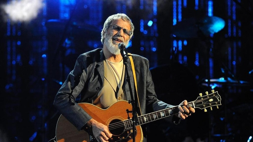 FILE - In this April 10, 2014 file photo, Hall of Fame Inductee Cat Stevens performs at the 2014 Rock and Roll Hall of Fame Induction Ceremony in New York. Stevens is canceling his New York performance just weeks after announcing a six-city tour. Stevens said on his Facebook page Wednesday, Sept. 24, 2014, that he would not keep the New York engagement because its requirement for paper tickets has led to exorbitant resale prices. (Photo by Charlse Sykes/Invision/AP, file)