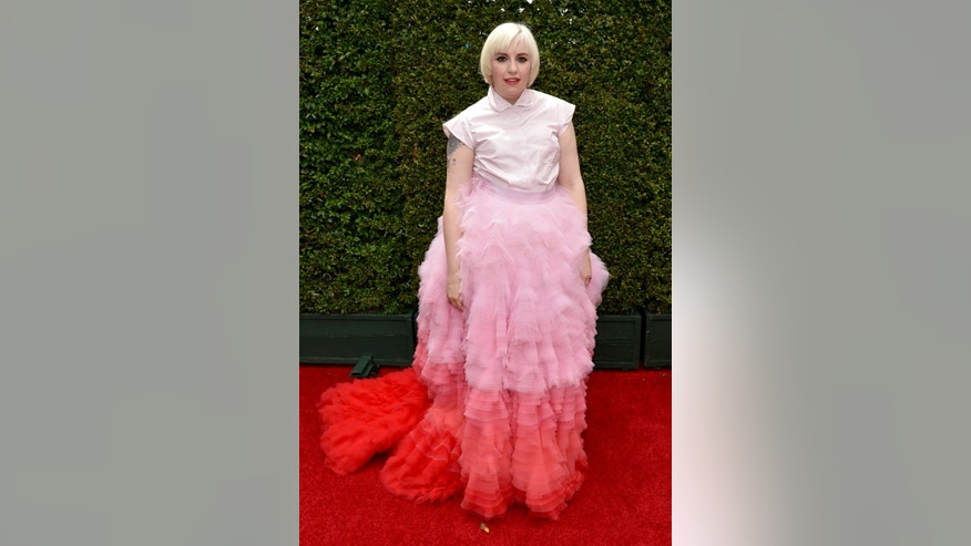 IMAGE DISTRIBUTED FOR THE TELEVISION ACADEMY - Lena Dunham arrives at the 66th Primetime Emmy Awards at the Nokia Theatre L.A. Live on Monday, Aug. 25, 2014, in Los Angeles. (Photo by John Shearer/Invision for the Television Academy/AP Images)