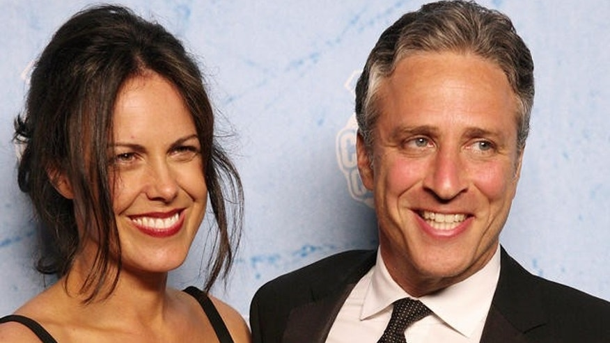 "Jon Stewart and his wife Tracey pose for photographers at the Comedy Central party, Sunday, Sept. 16,2007, in Los Angeles.  ""The Daily Show With Jon Stewart"" won the Emmy for  best ""Variety, Music or Comedy Series."" (AP Photo/Rene Macura)"