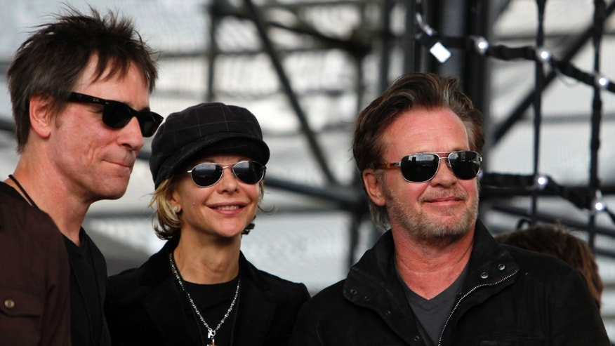 Sept. 22, 2012. John Mellencamp, right, and actress Meg Ryan, center, watch Dale Watson perform at the start of  Farm Aid 2012 concert at Hersheypark Stadium in Hershey, Pa.