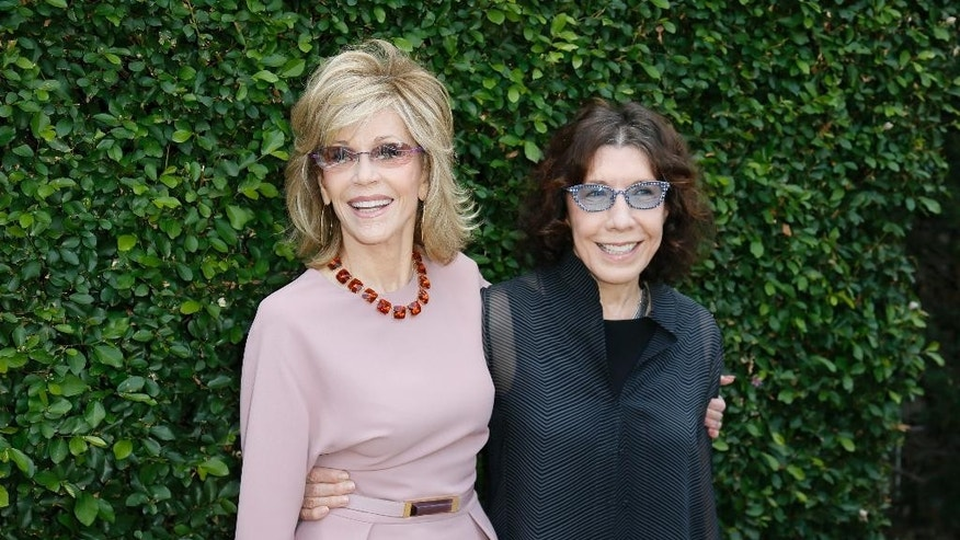 Actress and event host Jane Fonda and actress Lily Tomlin, right, pose at The Rape Foundation's Annual Brunch at Greenacres on Sunday, Sept. 28, 2014, in Beverly Hills, Calif. (Photo by Danny Moloshok/Invision/AP)