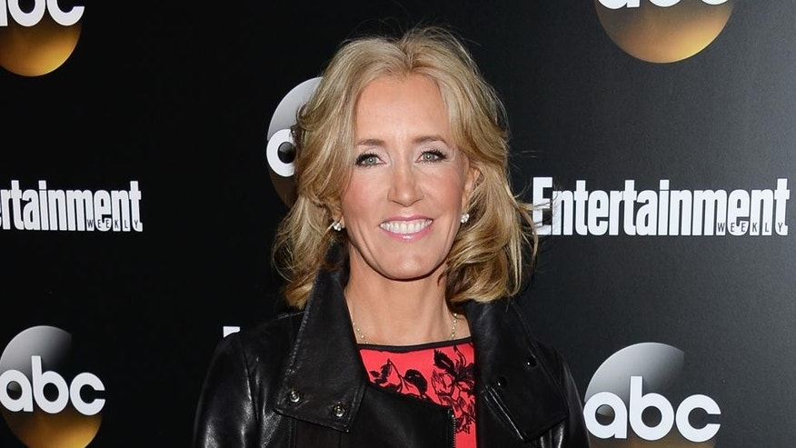 "FILE - In this May 13, 2014 file photo, actress Felicity Huffman attends the Entertainment Weekly and ABC network upfront party in New York. Huffman plays a mother in the upcoming drama ""American Crime,"" premiering on ABC in March 2015. (Photo by Evan Agostini/Invision/AP, File)"