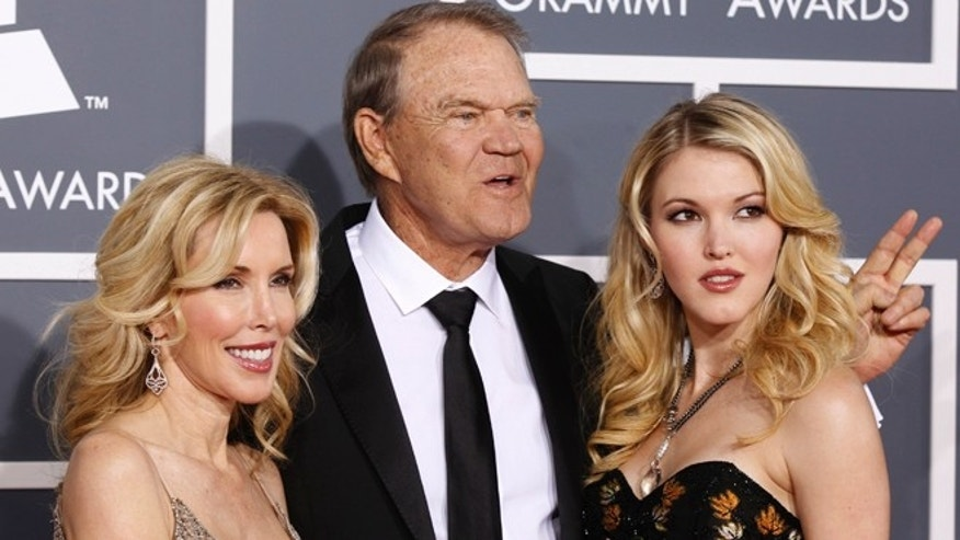 Glen Campbell, center, with his wife Kim, left, and daughter Ashley arrive at the 54th annual Grammy Awards in Los Angeles, California February 12, 2012.