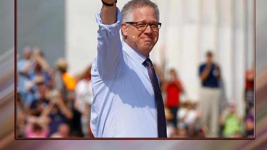 Glenn Beck waves as he arrives to speak at his  'Restoring Honor' rally in front of the Lincoln Memorial in Washington.