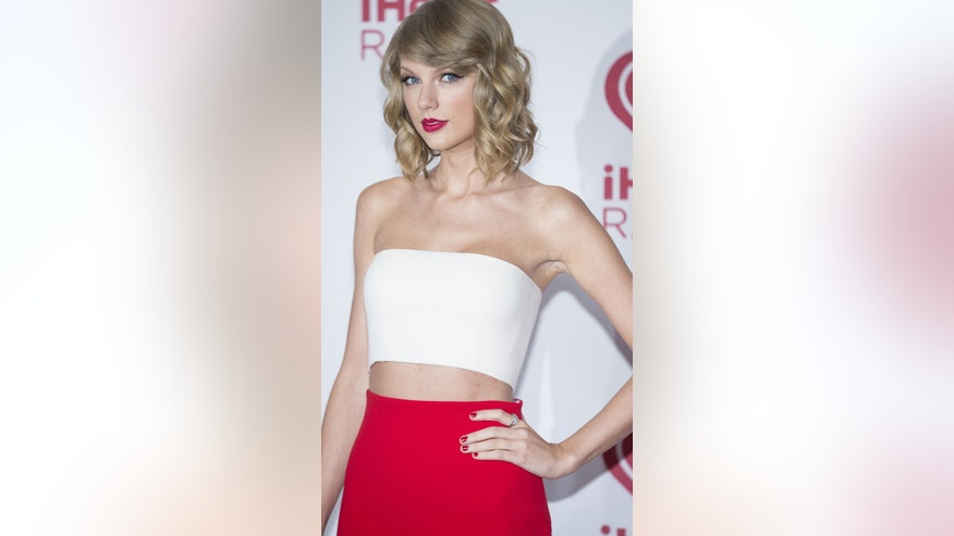 Taylor Swift arrives at the iHeart Radio Music Festival, Friday Sept. 19, 2014, at The MGM Grand Garden Arena in Las Vegas.