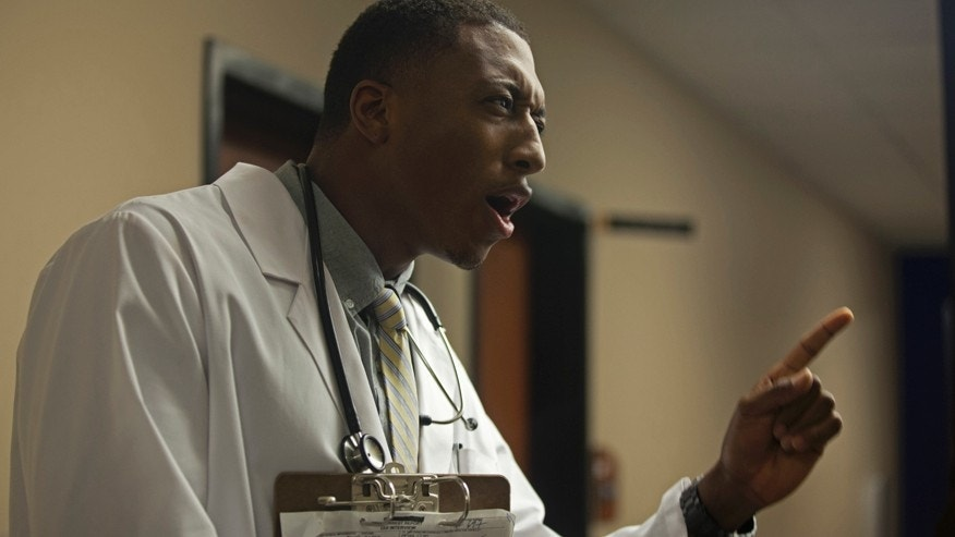 "Lecrae as Dr. Malmquist in ""Believe Me."""