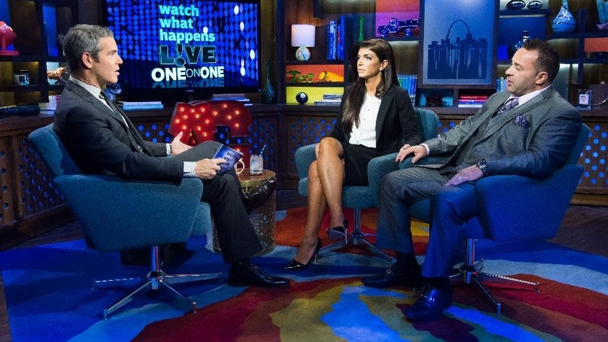 "In this image released by Bravo shows host Andy Cohen, left, speaks with Teresa Giudice, and her husband Joe Giudice, cast members on ""The Real Housewives of New Jersey,"" during a taping of ""Watch What Happens Live,"" airing Monday, Oct. 6, 2014 on Bravo. Teresa was sentenced to 15 months in prison on conspiracy and bankruptcy charges and Joe was sentenced to 41 months last Thursday in federal court in Newark, N.J. (AP Photo/Bravo, Charles Sykes)"