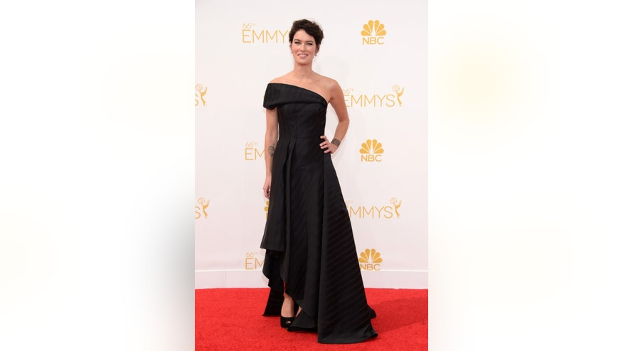 IMAGE DISTRIBUTED FOR THE TELEVISION ACADEMY - Lena Headey arrives at the 66th Primetime Emmy Awards at the Nokia Theatre L.A. Live on Monday, Aug. 25, 2014, in Los Angeles. (Photo by Evan Agostini/Invision for the Television Academy/AP Images)
