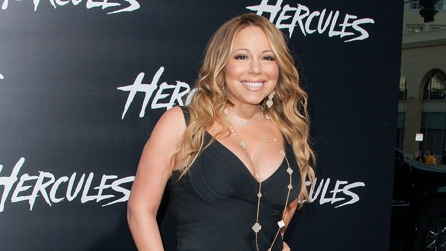 "Mariah Carey arrives at the premiere of ""Hercules"" on July 23, 2014 in Hollywood, California."