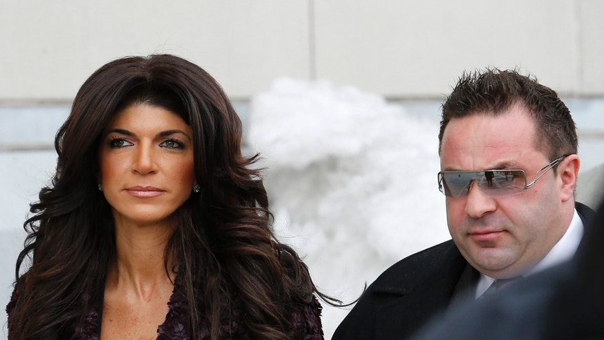 "Teresa Giudice, 41, (L) and her husband Giuseppe ""Joe"" Giudice, 43, exit the Federal Court in Newark, New Jersey, March 4, 2014. REUTERS/Eduardo Munoz (UNITED STATES - Tags: CRIME LAW ENTERTAINMENT) - RTR3G1B9"